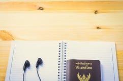 Accessories for traveler: passport earphone music and notebook. Accessories for traveler: passport earphone music and notebook royalty free stock photography