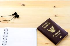 Accessories for traveler: passport earphone music and notebook.  royalty free stock images