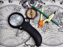 Accessories used for travel. A set of tools for travel on the background of the world map Stock Photo