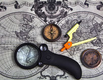Accessories used for travel. A set of tools for travel on the background of the world map royalty free stock photography
