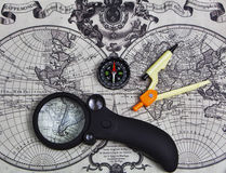 Accessories used for travel. A set of tools for travel on the background of the world map royalty free stock photo