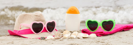 Accessories for vacation on sand at beach, sun protection, summer time Stock Images