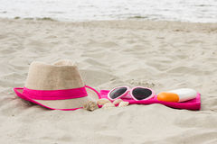 Accessories for vacation on sand at beach, sun protection, summer time Stock Image