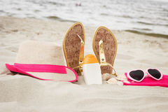 Accessories for vacation on sand at beach, sun protection, summer time Royalty Free Stock Image