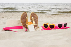 Accessories for vacation on sand at beach, sun protection, summer time Stock Photo