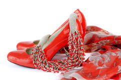 Accessories for women. Orange accessories for women shoes, beads, neckerchief on a white background Stock Image