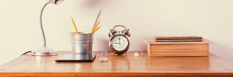 Accessories Wooden Office Desk Alarm Clock Lamp Royalty Free Stock Photos