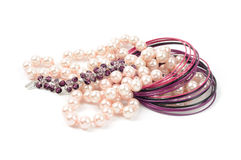 Accessory. Pearl necklace and bracelets on white backgroud Royalty Free Stock Image