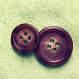 Accessory. Thread and buttons on the fabric royalty free stock image