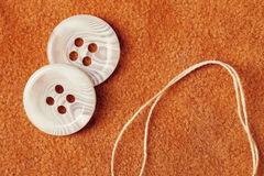 Accessory. Thread and buttons on the fabric stock photos