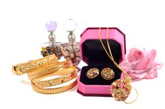 Accessory. Golden set and gold bracelets with accessory, over white royalty free stock photo