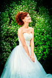 Accessory. Beautiful smiling bride with chaming red hair. Wedding dress and accessories. Wedding decoration Royalty Free Stock Images