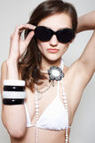 Accessory. Fashion woman in swimsuit & sunglasses Stock Photo