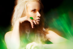 Accessory, jewelry. Rich woman with big jewel ring. Luxury blond woman model with fashion dark make-up, glamour volume curly hair, chic jewelry. Accessories royalty free stock photos