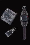 Accessory kit. biker watch, wallet and key ring. On black background Royalty Free Stock Photos