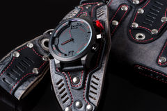 Accessory kit. biker watch, wallet and key ring. On black background Royalty Free Stock Photo