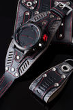 Accessory kit. biker watch, wallet and key ring. On black background Royalty Free Stock Image
