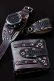 Accessory kit. biker watch, wallet and key ring. On black background Stock Image