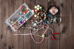 Accessory for making home craft art jewellery. Layout on wooden table royalty free stock photography