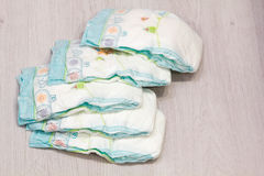 Accessory set for Baby disposable diapers on gray background tree, items for baby care. Lay diaper nappy, the parent taking care b. Aby breast milk the bottle Royalty Free Stock Image