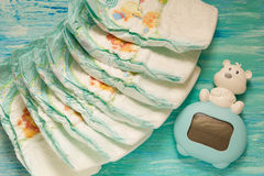 Accessory set for Baby disposable diapers on a turquoise background tree Royalty Free Stock Photography
