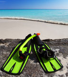 Accessory for Snorkeling -mask, flippers,  tube-lay on sand on background of ocean Stock Photo