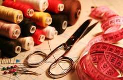 Accessory of the tailor. Scissors, stitching, measuring tape Royalty Free Stock Photo
