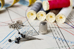 Accessory of the tailor. Pins, thread, buttons, pins, tape, thimble and pattern stock photos