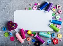 Accessory of the tailor sewing. And paper card Royalty Free Stock Images