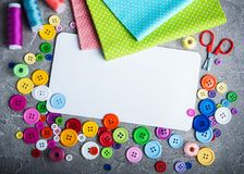 Accessory of the tailor sewing. And paper card stock photo