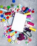 Accessory of the tailor sewing. And paper card Royalty Free Stock Photo