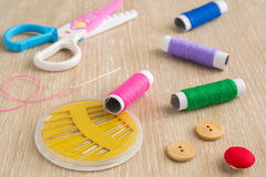 Accessory of the tailor on wooden background Stock Photo
