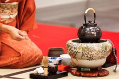 The accessory for the tea ceremony. Japan. Kawaii. The woman prepares the tea during performance of tea ceremony. The accessory is in the foregroound of the stock images