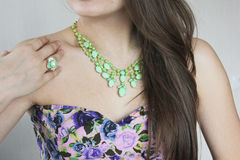 Accessory. Tender green necklace and ring Stock Photos