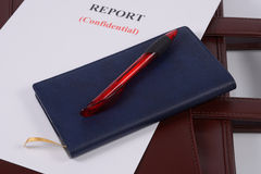 Red pen and blue notebook Stock Images