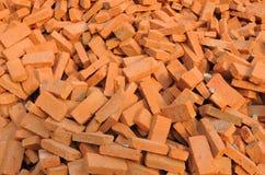 Acción anaranjada del ladrillo para la construcción de viviendas Fotografía de archivo libre de regalías