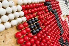 Acción blanca, roja y negra para los huevos Imagen de archivo libre de regalías