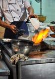 Acción caliente en el wok Imagen de archivo libre de regalías