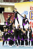Acción Cheerleading del campeonato Imagenes de archivo