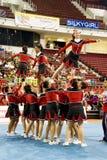 Acción Cheerleading del campeonato Foto de archivo libre de regalías
