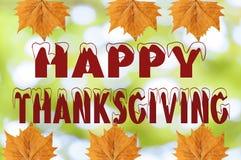 Acción de gracias feliz escrita en fondo borroso con la hoja Fotos de archivo