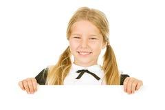Acción de gracias: La muchacha linda del peregrino mira sobre la tarjeta blanca Foto de archivo