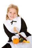 Acción de gracias: Peregrino de la muchacha que sostiene las calabazas y maíz indio Imagen de archivo
