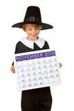 Acción de gracias: Peregrino que sostiene el calendario para 2013 Imágenes de archivo libres de regalías