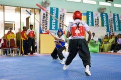 Acción de la lucha del palillo (Silambam) Imagen de archivo