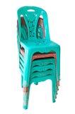 Acción de sillas plásticas verdes Imágenes de archivo libres de regalías