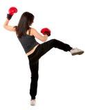 Acción del boxeo de retroceso de la mujer Fotos de archivo libres de regalías