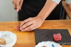 Acción del cocinero Fotografía de archivo