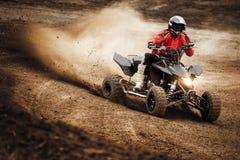 Acción del deporte de la raza del motocrós de ATV Imagen de archivo libre de regalías