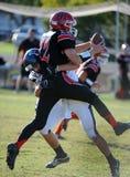 Acción del fútbol de la High School secundaria Foto de archivo libre de regalías